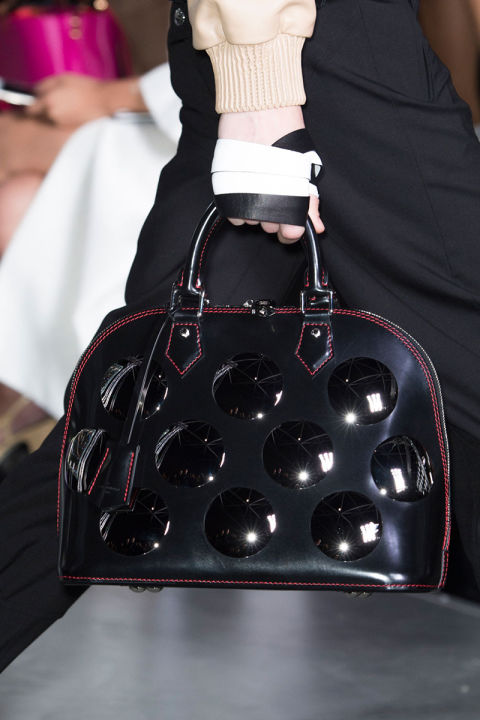 Whether you wear it at your elbow, or simply let your assistant tote it, the top handle is this season's ladylike winner. Pictured: Louis Vuitton