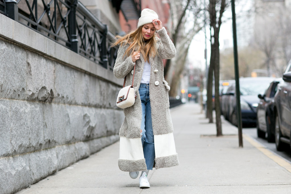18. With a Long Fuzzy Jacket, a White T-Shirt, Socks, and Sneakers. Image Source: IMAXTREE / vincenzogrillo.com