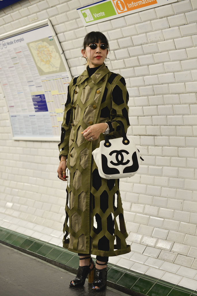 PARIS, FRANCE - JUNE 28: Sachico Nishihara poses wearing Comme des Garcons coat and Chanel bag after the Y3 show at the Lycee Carnot on June 28, 2015 in Paris, France.  (Photo by Vanni Bassetti/Getty Images)