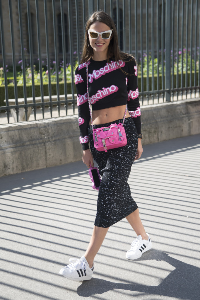 PARIS, FRANCE - SEPTEMBER 26: Fashion Buyer and Blogger Zina Charkoplia is wearing a Moschino iPhone case, Proenza Schouler bag, top and skirt, Adidas trainers and Marc Jacobs sunglasses on day 4 of Paris Collections: Women on September 26, 2014 in Paris, France.  (Photo by Kirstin Sinclair/Getty Images)
