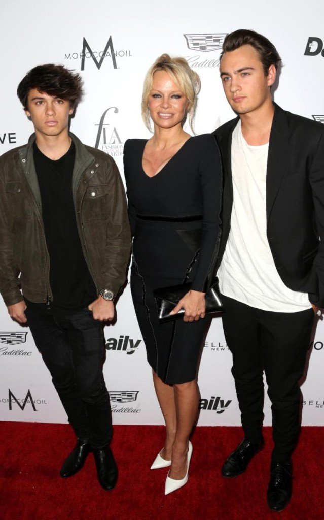 Pin-up Pamela Anderson with her two sons, Dylan Jagger (left) and Lee Brandon Thomas Lee, Getty