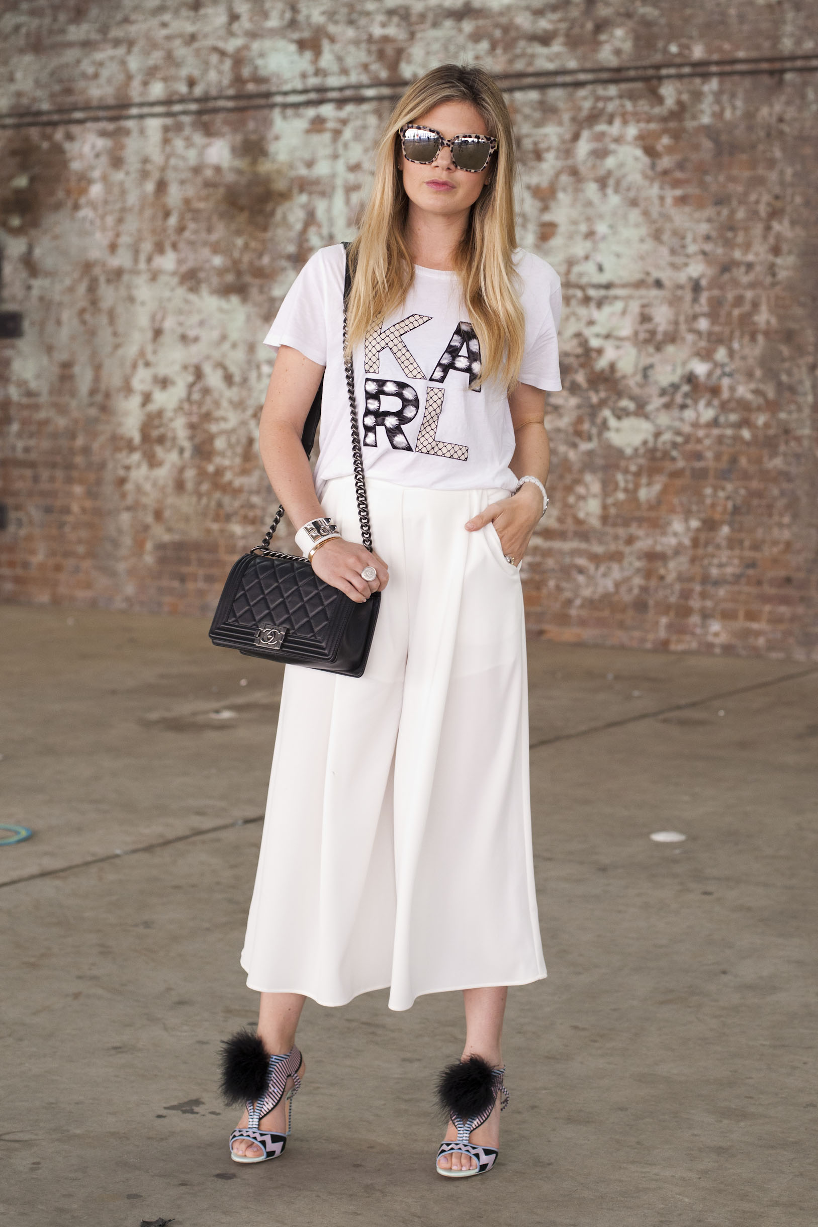 SYDNEY, AUSTRALIA - APRIL 14:  Fashion Blogger Jess Dempsey wears a Karl Lagerfeld shirt,The Fifth trousers, Chanel bag and Dolce and Gabbana sunglasses at Mercedes-Benz Fashion Week Australia 2015 at Carriageworks on April 14, 2015 in Sydney, Australia.  (Photo by Merilyn Smith/WireImage)