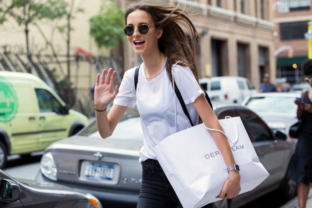 Brazilian model Waleska Gorczevski waves after the Tibi show at The Waterfront Building on September 12, 2015 in New York City. Waleska wears a round metal Ray-Ban sunglasses, a white t-shirt, and black skinny jeans.