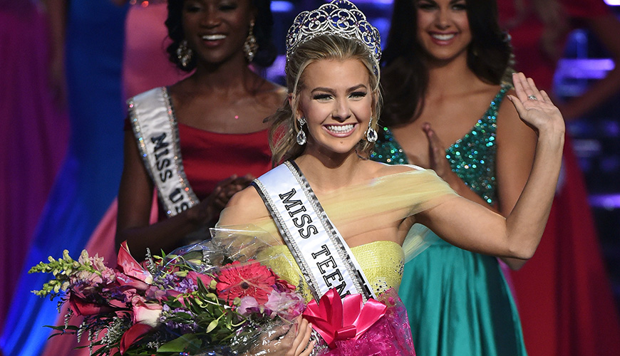 LAS VEGAS, NV - JULY 30:  Miss Texas Teen USA 2016 Karlie Hay waves after being crowned Miss Teen USA 2016 as Miss USA 2016 Deshauna Barber (L) and Miss Teen USA 2015 Katherine Haik (R) look on during the 2016 Miss Teen USA Competition at The Venetian Las Vegas on July 30, 2016 in Las Vegas, Nevada.  (Photo by Ethan Miller/Getty Images)