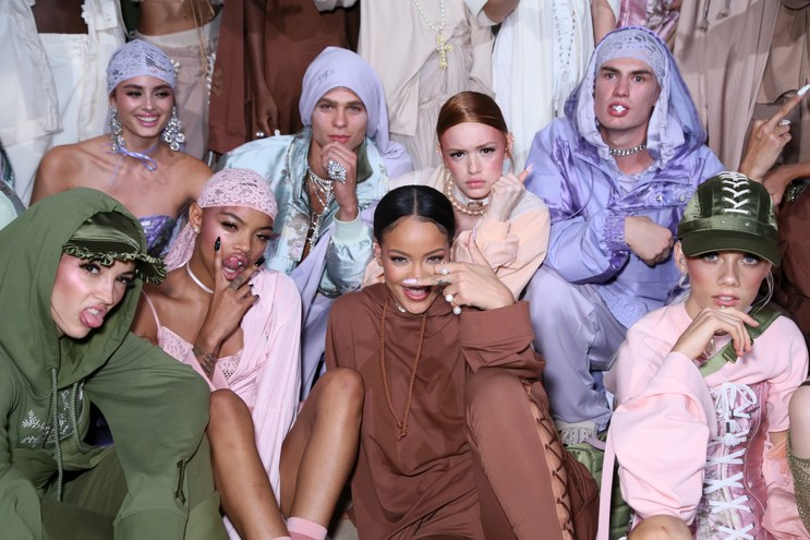 Rihanna poses backstage with models from her Fenty x Puma spring/summer 2017 show in Paris PHOTO: GETTY IMAGES