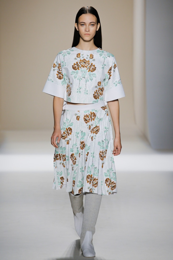 Victoria Beckham Spring 2017: Model walks runway in floral print cropped shirt and pleated mid-length skirt