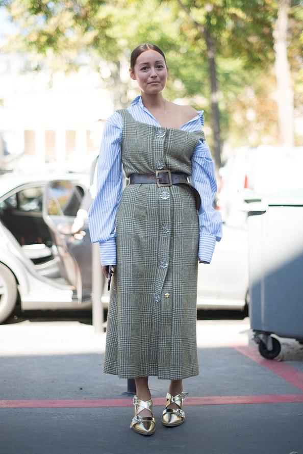 Allure fashion director, Rachel Wang, layered her off-the-shoulder top with a wool dress. Getty Images