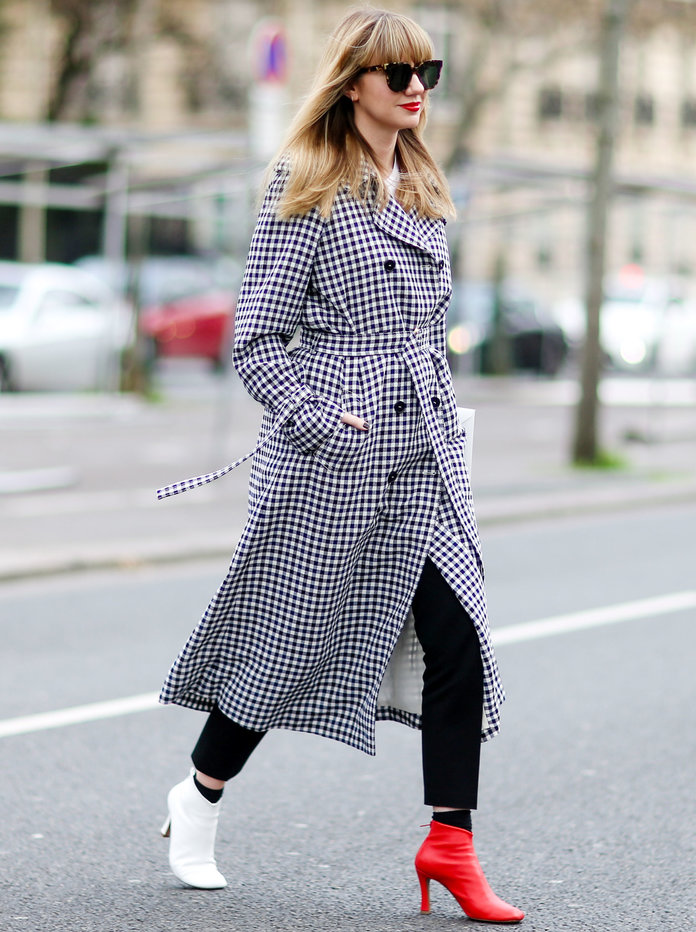 PARIS, FRANCE - MARCH 07:  Lisa Aiken wears a checked trench coat, a red shoes, and a white shoe, outside the Ellery show, during Paris Fashion Week Womenswear Fall/Winter 2017/2018, on March 7, 2017 in Paris, France.  (Photo by Edward Berthelot/Getty Images)