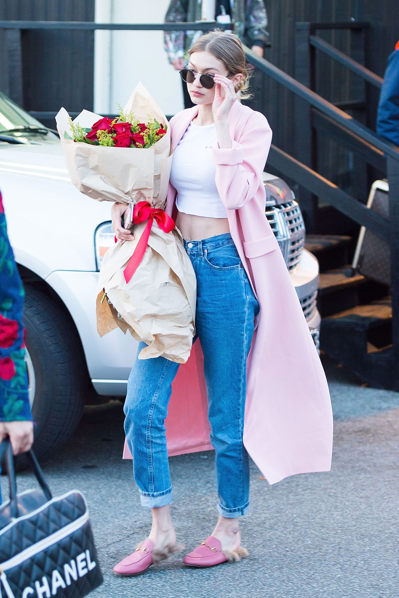 Gigi Hadid carrying one bouquet of flowers out in New York City.  / GETTY