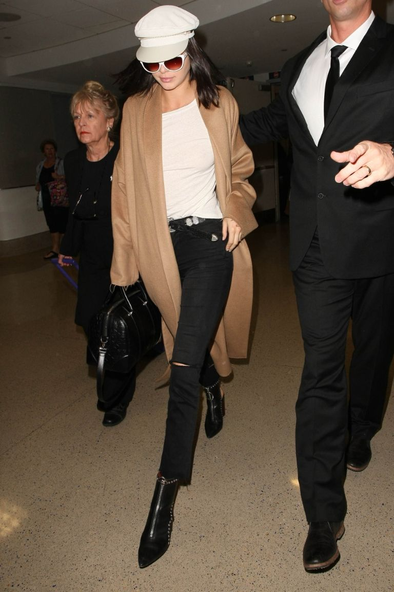 Kendall Jenner wearing a white Greek fisherman's hat at LAX on March 13.