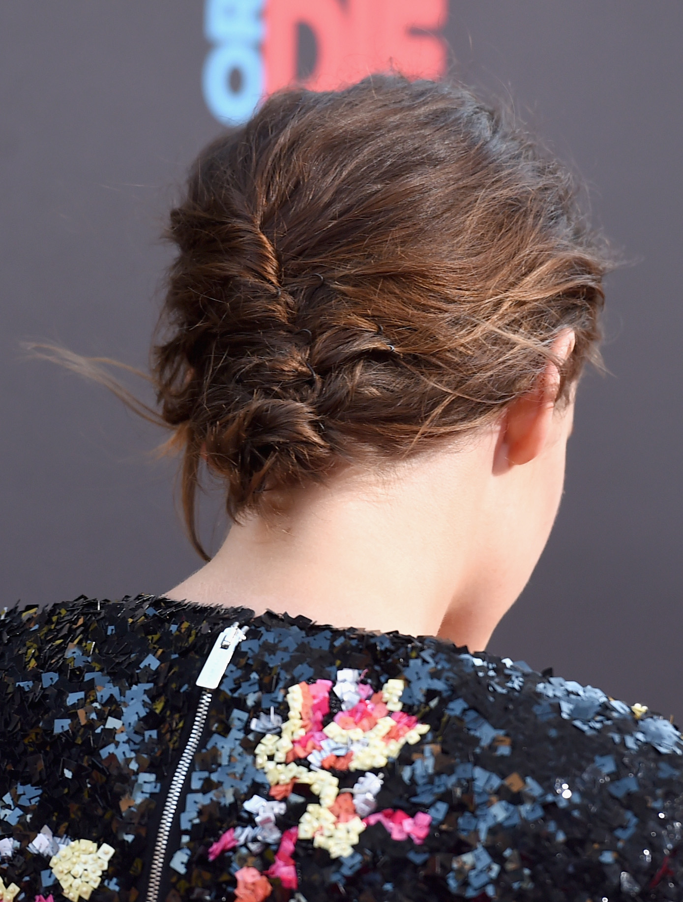 "LOS ANGELES, CA - AUGUST 18:  Actress Kristen Stewart, hair detail, attends the premiere of Lionsgate's ""American Ultra"" at Ace Theater Downtown LA on August 18, 2015 in Los Angeles, California.  (Photo by Jason Merritt/Getty Images)"