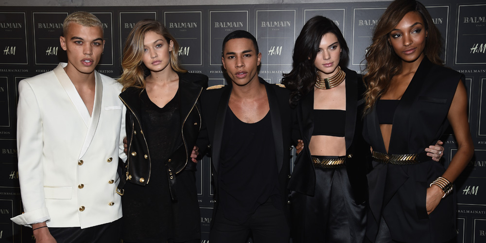 NEW YORK, NY - OCTOBER 20:  (L-R) Models Dudley O'Shaughnessy, Gigi Hadid, Kendall Jenner, and Jourdan Dunn pose with the Creative Director of Balmain Olivier Rousteing (C) at the BALMAIN X H&M Collection Launch at 23 Wall Street on October 20, 2015 in New York City.  (Photo by Dimitrios Kambouris/Getty Images for H&M)