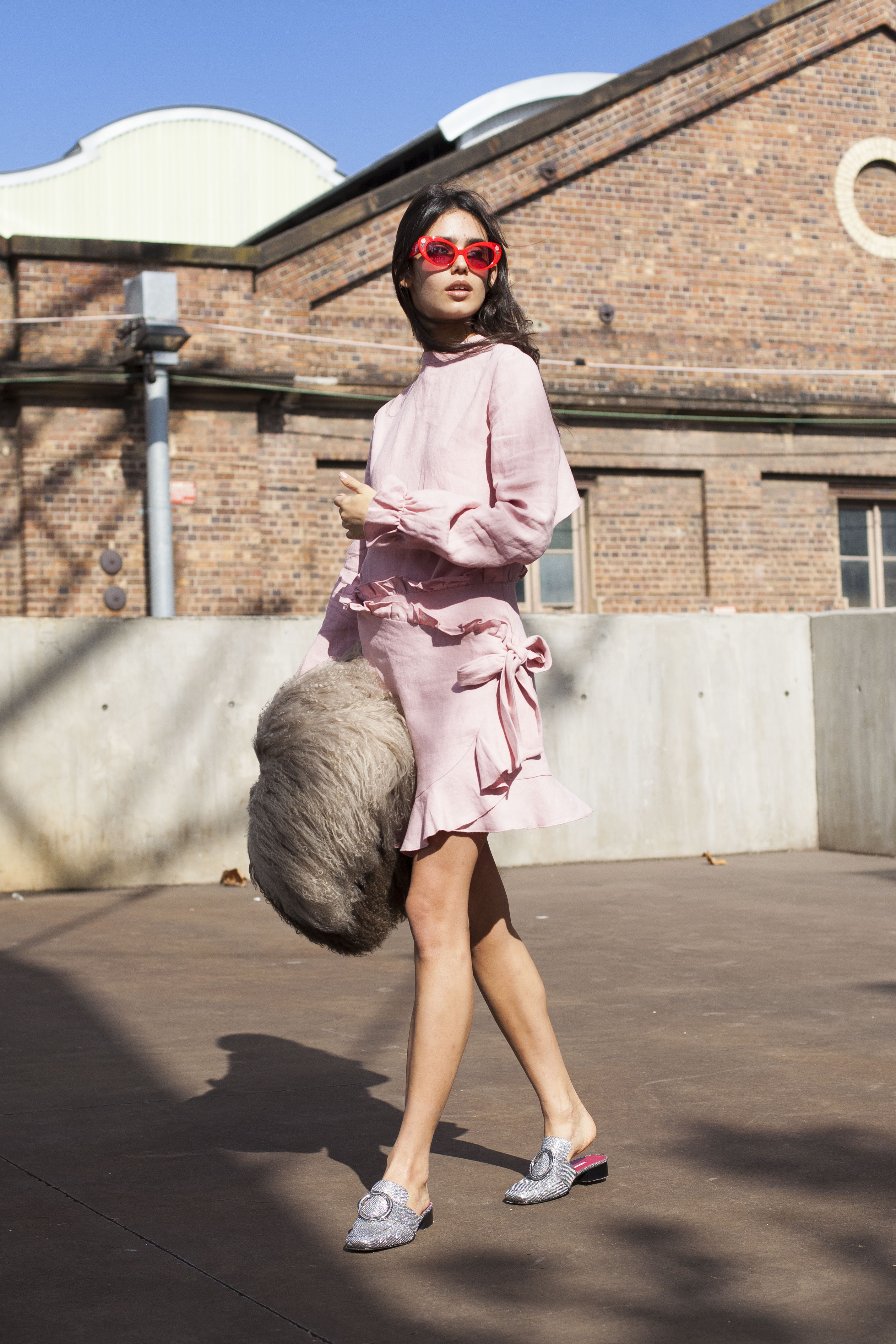 SYDNEY, AUSTRALIA - MAY 18:  Model and Student Talia Berman wearing a Tuchuzy top, Poppy Lissiman sunglasses, Saks Sports coat and Dorateymur shoes during Mercedes-Benz Fashion Week Resort 18 Collections at Carriageworks on May 18, 2017 in Sydney, Australia.  (Photo by Merilyn Smith/WireImage)