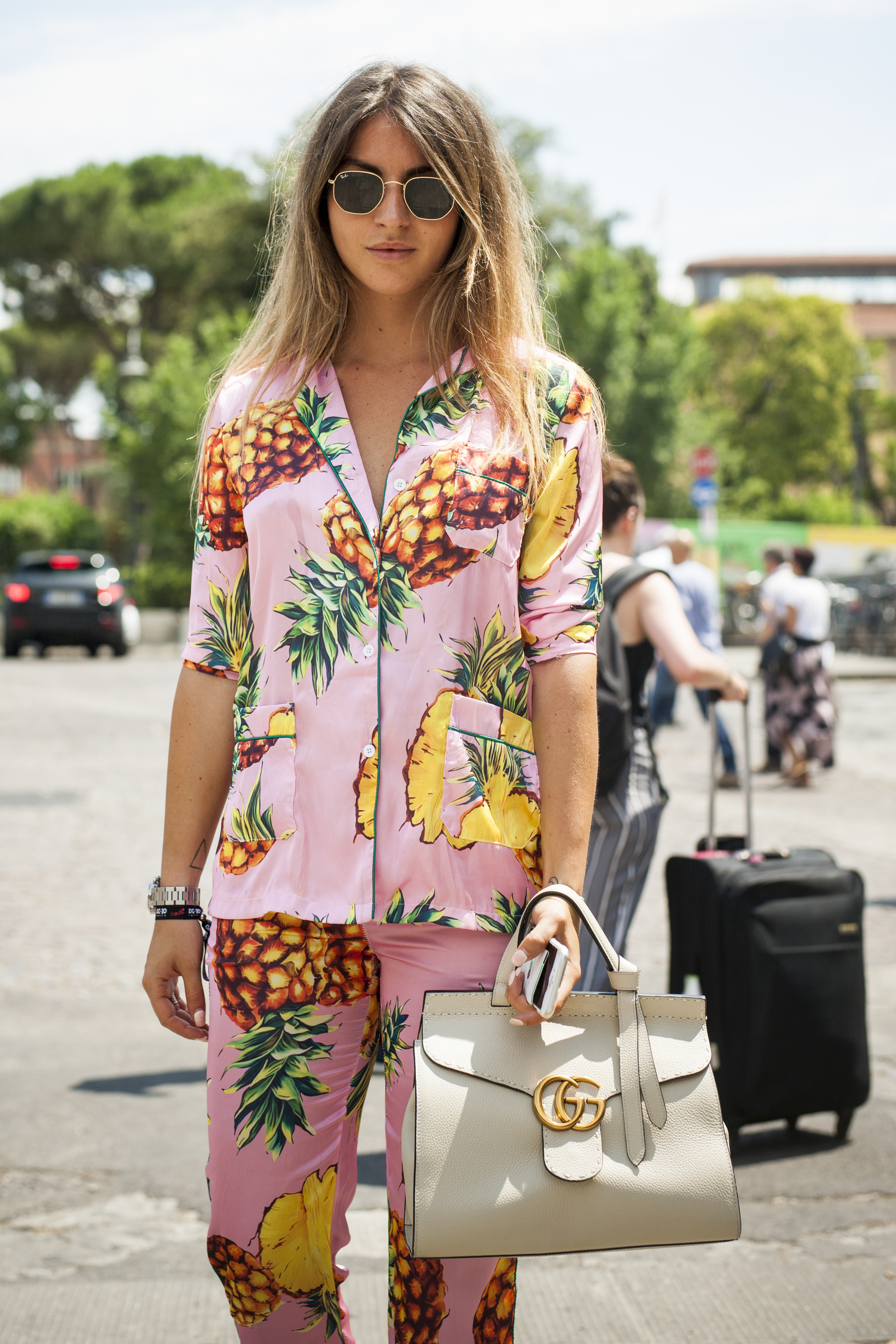 FLORENCE, ITALY - JUNE 15:  Lucrezia Trinca wears a pink pyjama with pineapple stamps and Gucci bag during Pitti Immagine Uomo 92. at Fortezza Da Basso on June 15, 2017 in Florence, Italy.  (Photo by Claudio Lavenia/Getty Images)
