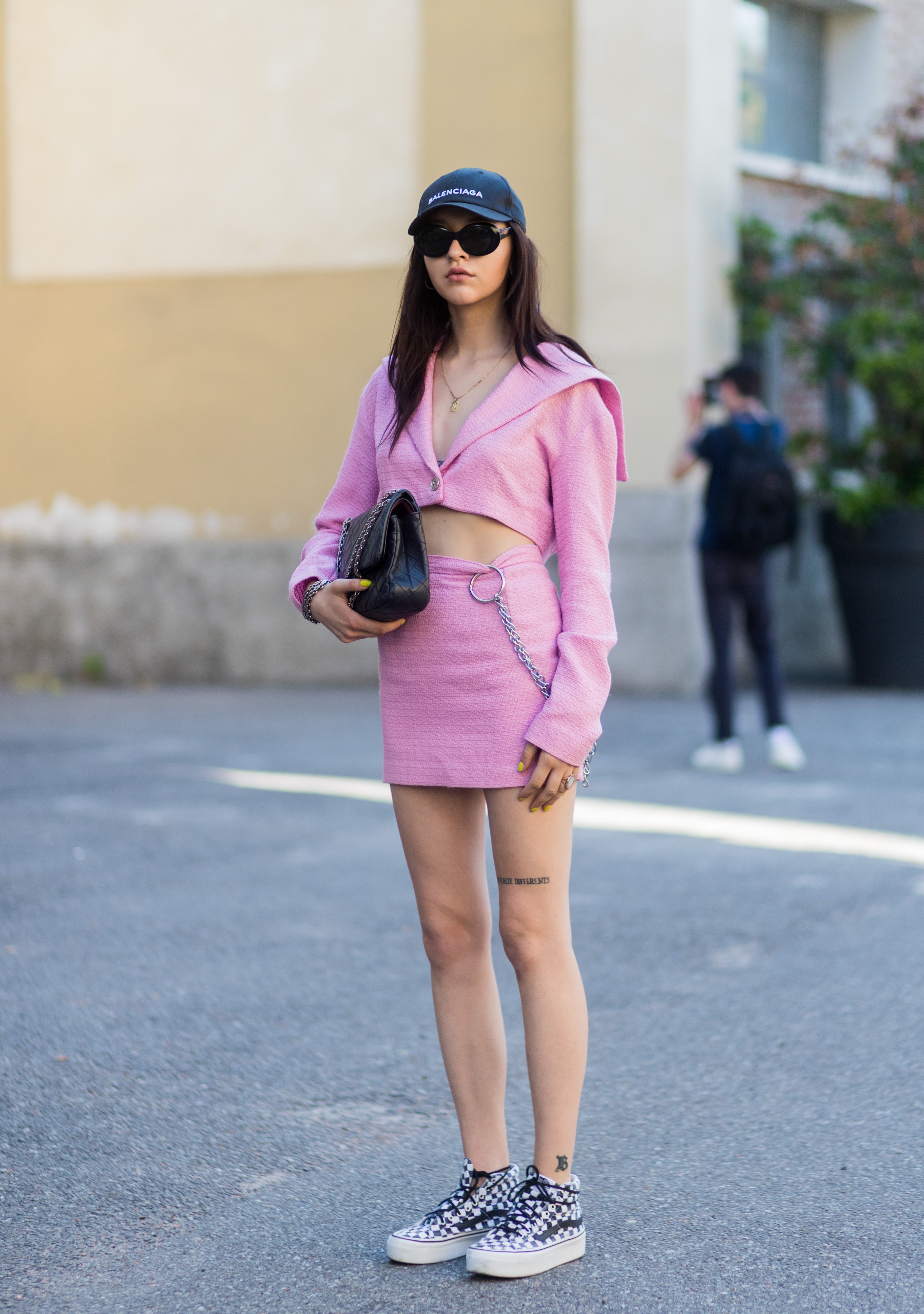 MILAN, ITALY - JUNE 19: A guest wearing a pink skirt, cropped jacket, Balenciaga cap, Chanel bag is seen outside Malibu 1992 during Milan Men's Fashion Week Spring/Summer 2018 on June 19, 2017 in Milan, Italy. (Photo by Christian Vierig/Getty Images)