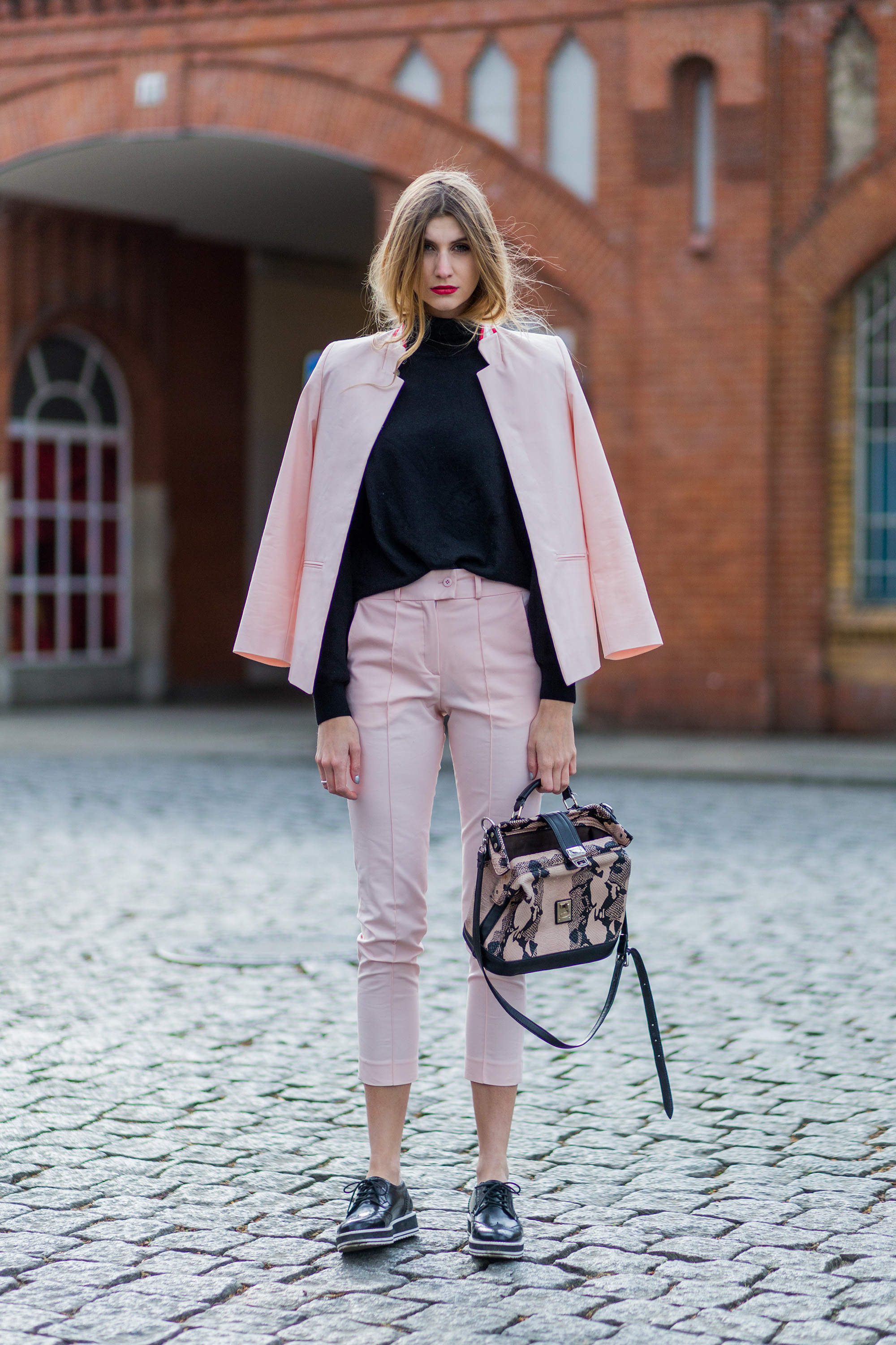 BERLIN, GERMANY - APRIL 9: Kimyana Hachmann wearing a pink blazer and 7 8 pants from Valentine Gauthier, black Forever 21 shoes, black turtleneck sweater and vintage bag on April 9, 2016 in Berlin, Germany (Photo by Christian Vierig/Getty Images)