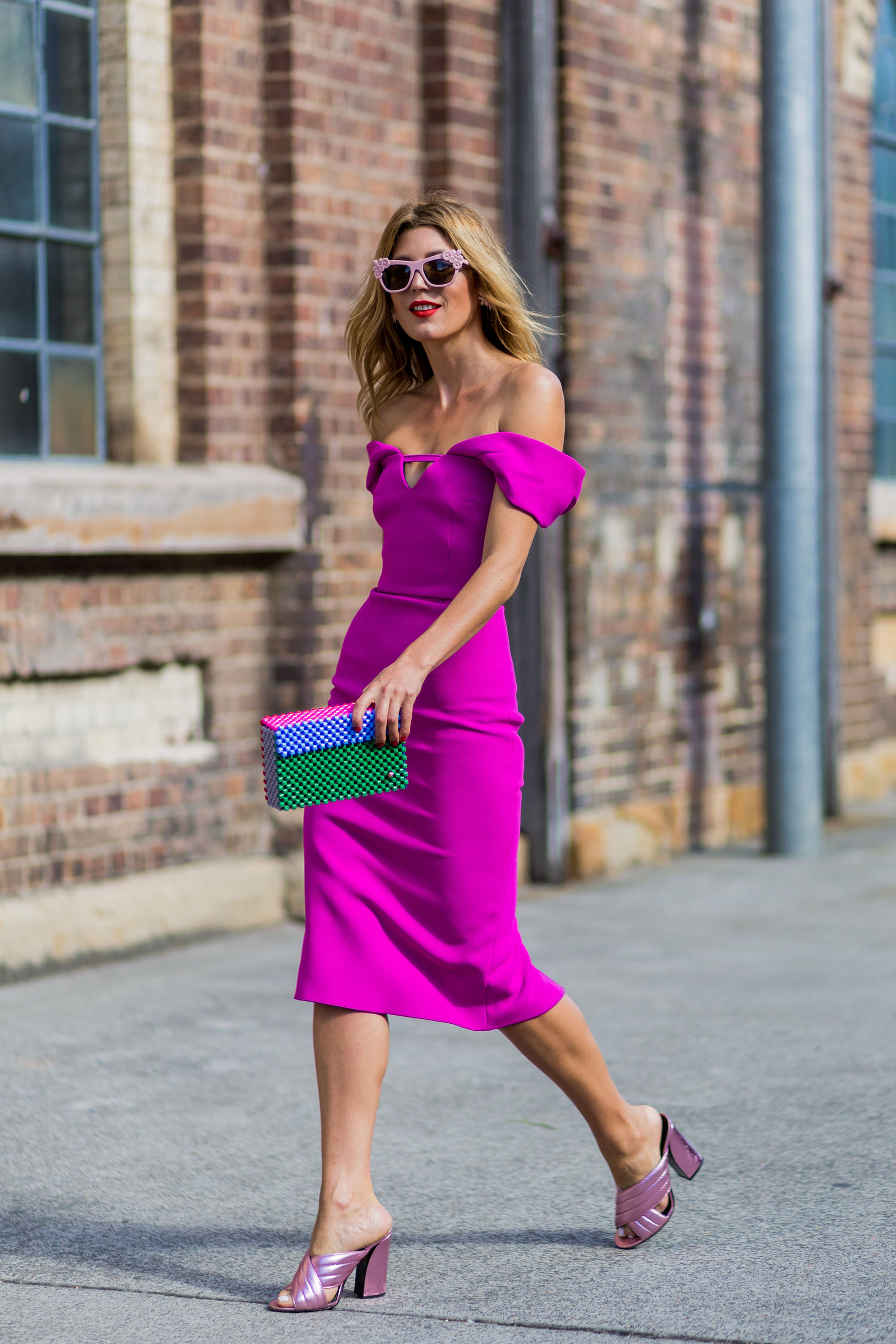 SYDNEY, AUSTRALIA - MAY 16: Tanja Gacic wearing a pink off shoulder dress from Yeojin Bae, a Lucy Folg clutch, Preen sunglasses and Gucci sandals outside Yeojin Bae at Mercedes-Benz Fashion Week Resort 17 Collections at Carriageworks on May 16, 2016 in Sydney, Australia.   (Photo by Christian Vierig/WireImage)