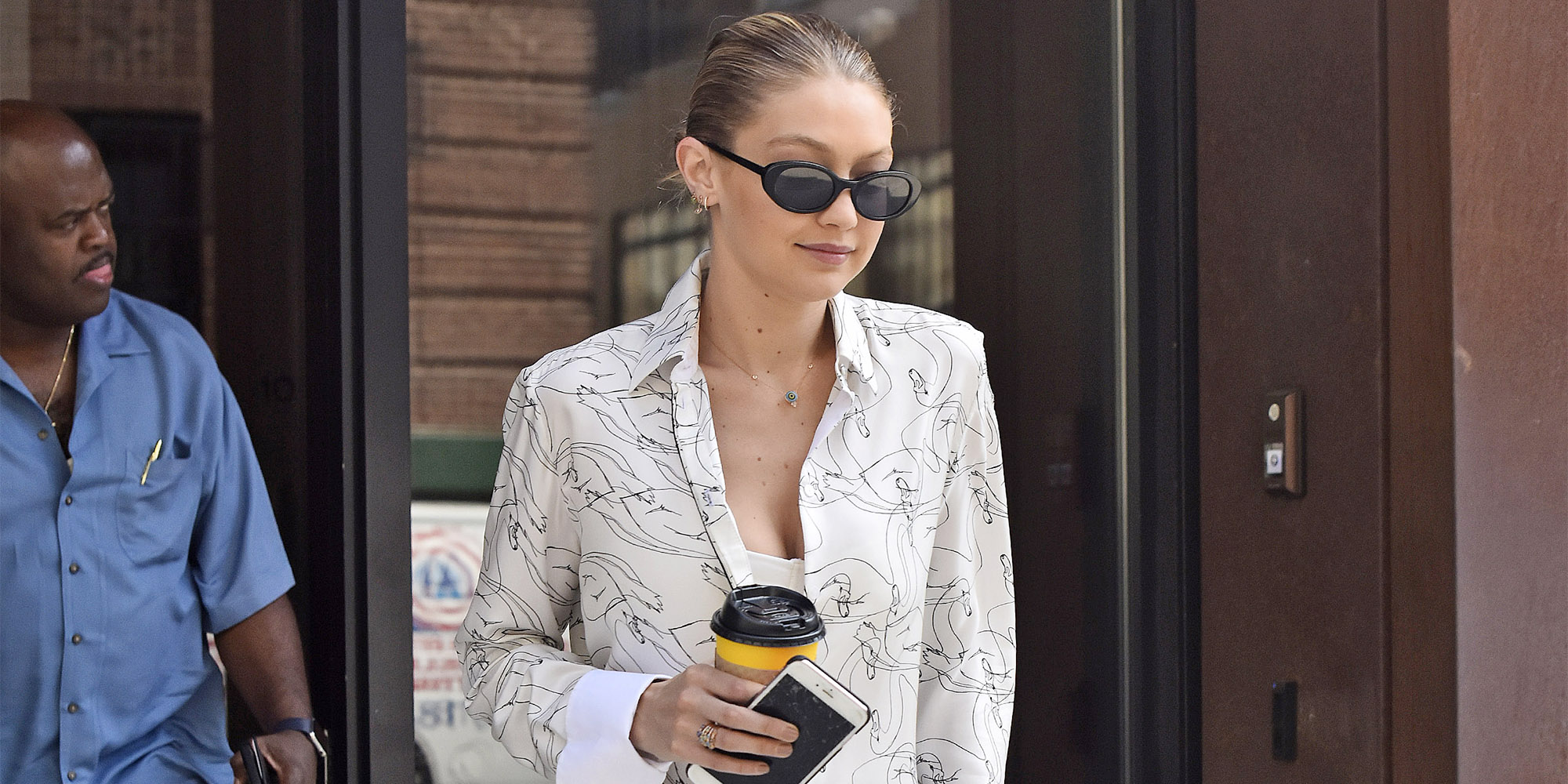 EXCLUSIVE: Gigi Hadid wears a white patterned summer dress and Gucci slippers while heading out in New York City, New York.  Pictured: Gigi Hadid Ref: SPL1536069  160717   EXCLUSIVE Picture by: Edward Opi / Splash News  Splash News and Pictures Los Angeles:310-821-2666 New York:212-619-2666 London:870-934-2666 photodesk@splashnews.com