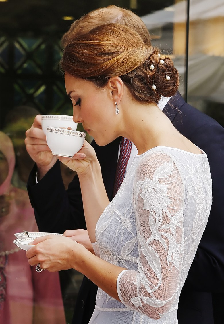 Catherine, Duchess of Cambridge drinks tea at the British High Commission in Kuala Lumpur, Malaysia. September, 2012 Photo: Getty Images