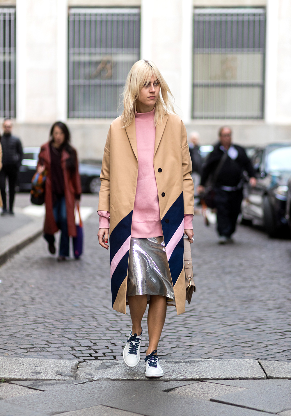 MILAN, ITALY - FEBRUARY 26: Linda Tol wearing pink knit, beige coat, silver skirt, JW Anderson bag, white sneaker outside Salvatore Ferragamo during Milan Fashion Week Fall/Winter 2017/18 on February 26, 2017 in Milan, Italy. (Photo by Christian Vierig/Getty Images)