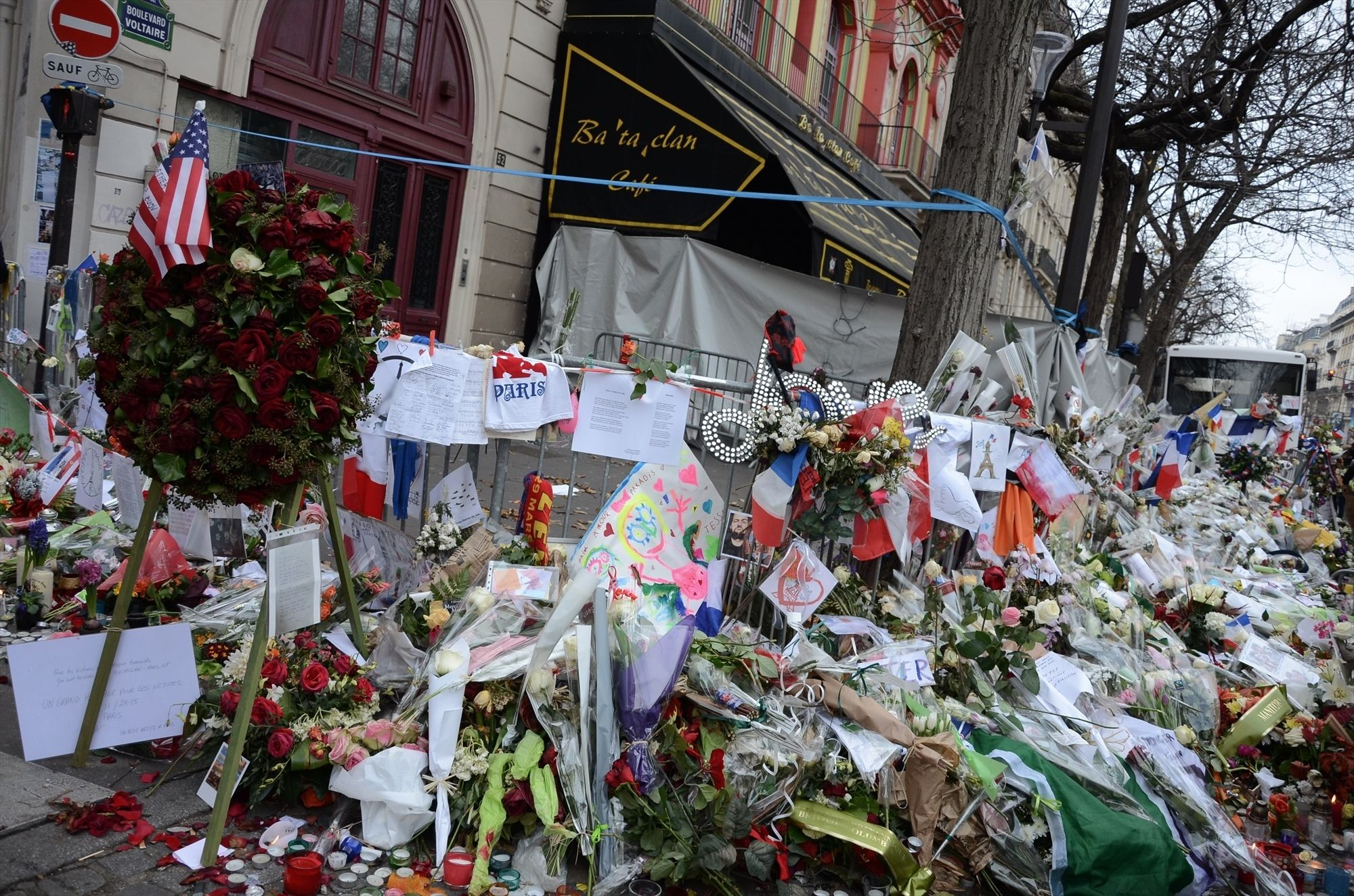 Parisian's react to the 2015 terrorist attacks with bouquets of flowers near the Bataclan. Getty