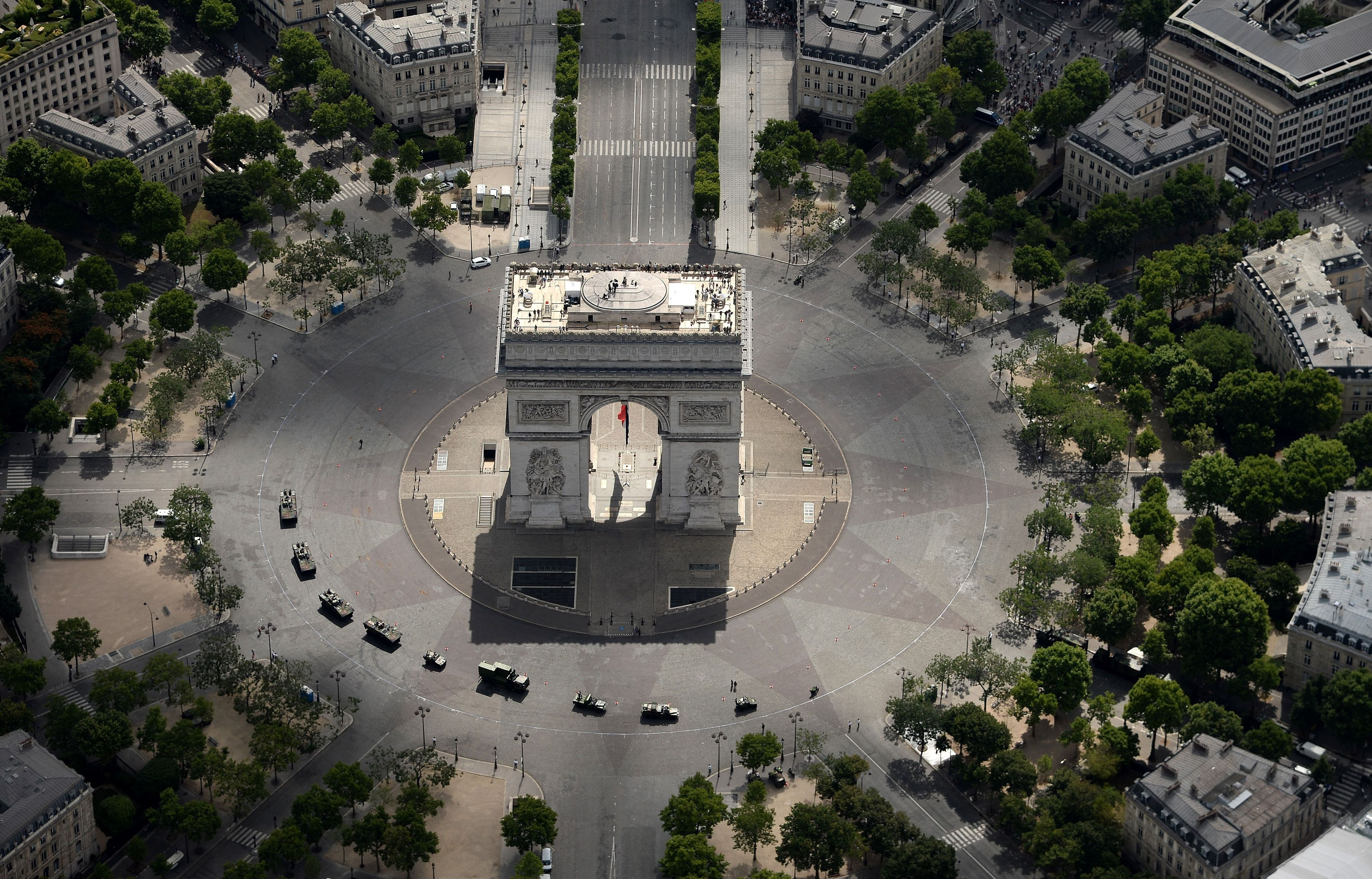 Military trucks circle the Champs Elysées after the 2015 terrorist attacks./ Getty