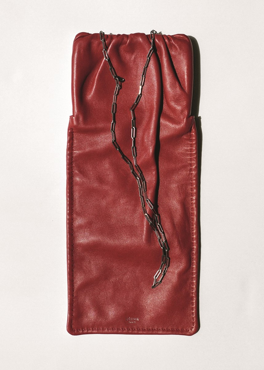 Leather vertical ruched bag by Céline. Photography by Tim Elkaïm, Styling by Chloe Grace Press