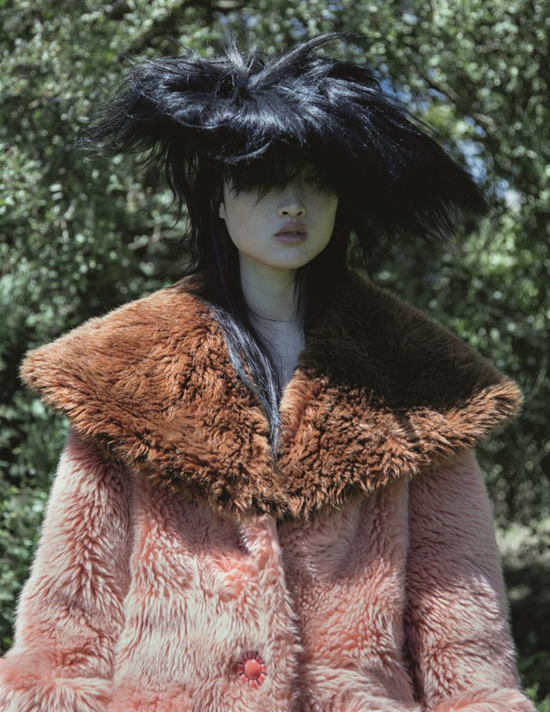 Eco-fur coat with large collar by Miu Miu, goat-hair hat by John Galliano. Photography by Jackie Nickerson, Styling by Agata Belcen and Nell Kalonji