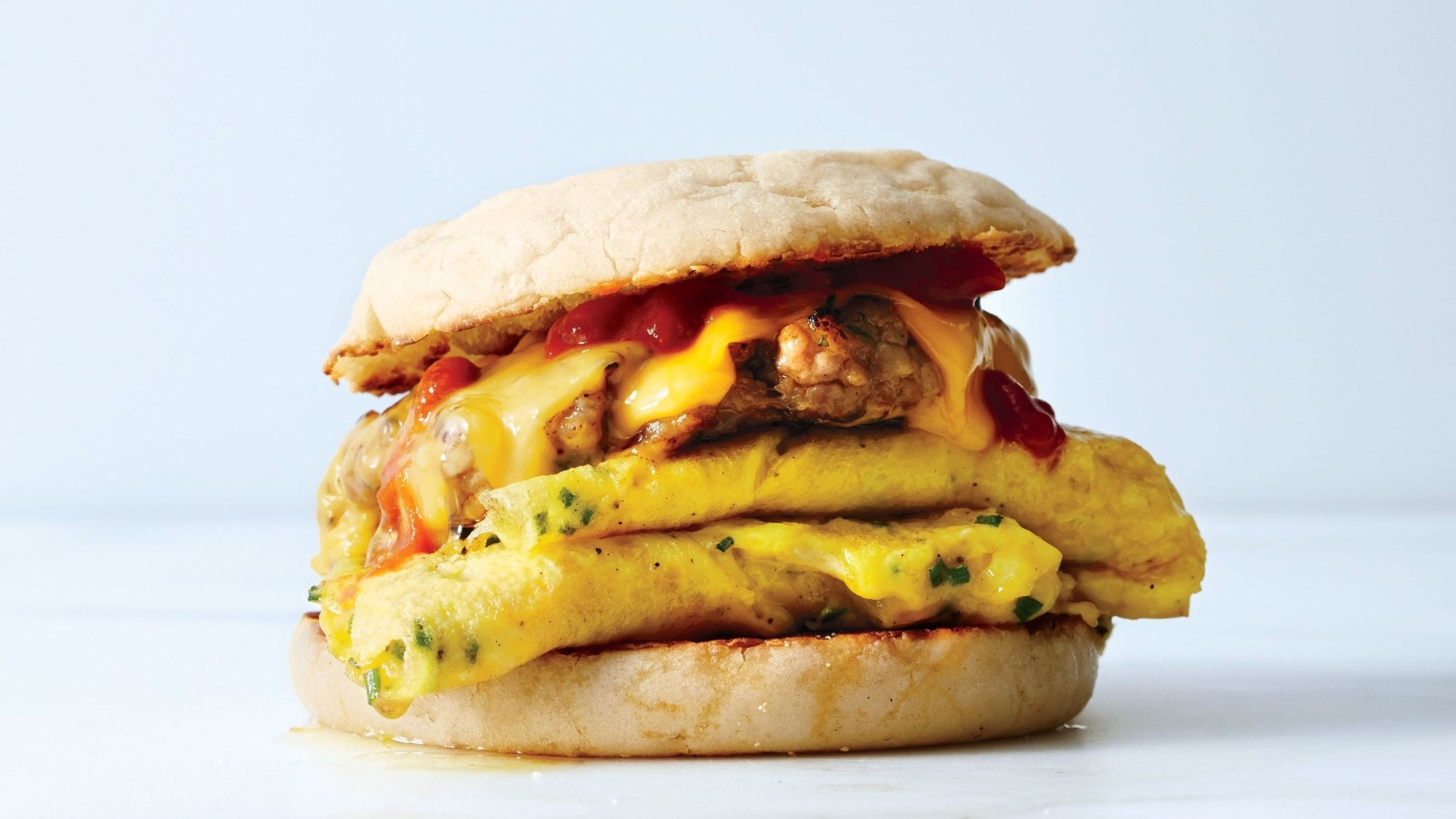 The leaning tower of breakfast sandwich is completed by the homemade sausage patty up top!