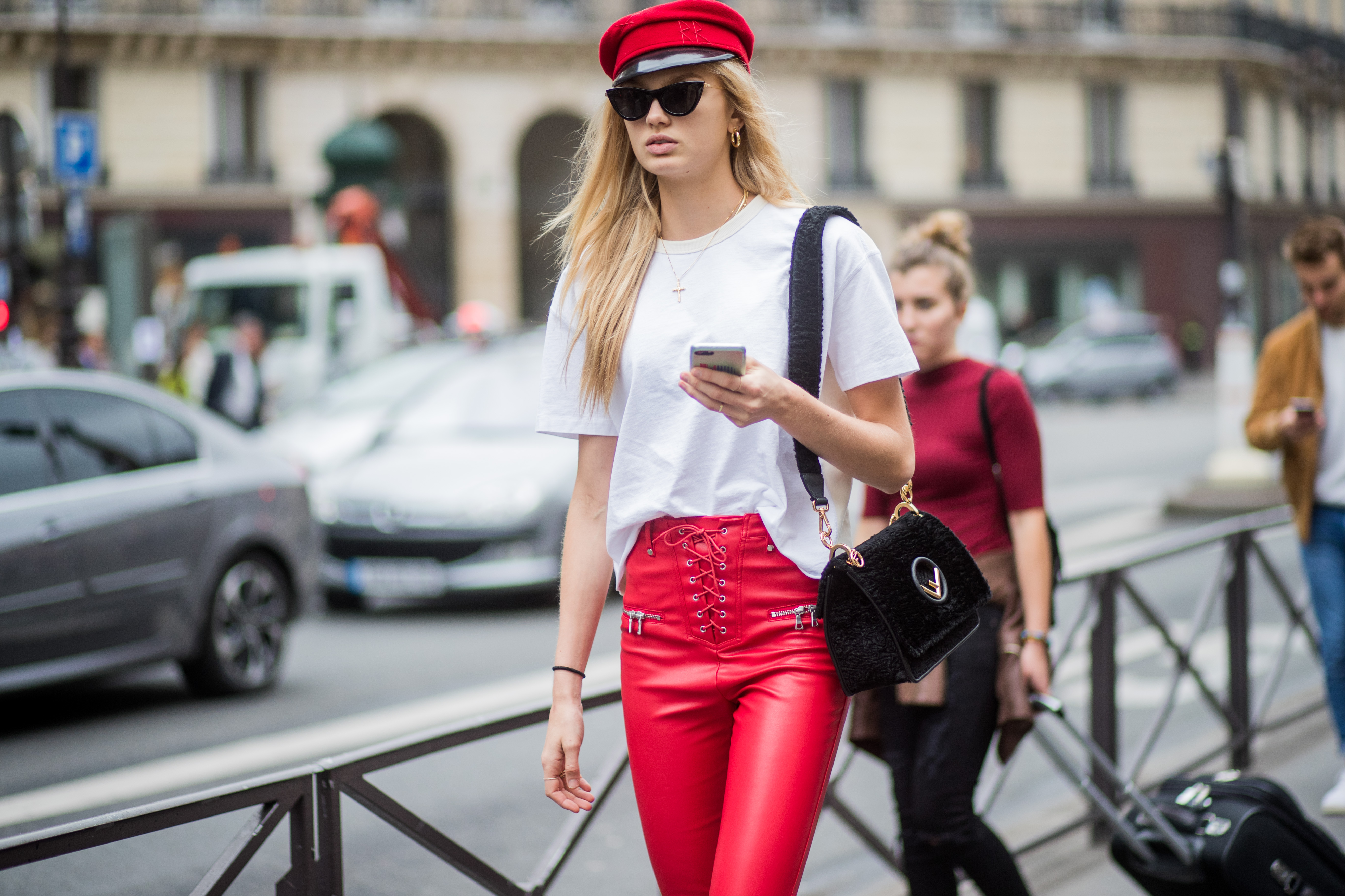 PARIS, FRANCE - SEPTEMBER 28: Model Romee Strijd wearing red flat hat, white tshirt, Fendi bag, red leather pants, white boots is seen outside Balmain during Paris Fashion Week Spring/Summer 2018 on September 28, 2017 in Paris, France. (Photo by Christian Vierig/Getty Images)