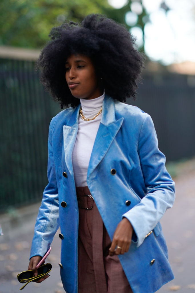 PARIS, FRANCE - SEPTEMBER 30:  A guest wears a blue jacket, a white tutleneck, outside CDG Comme des Garcons, during Paris Fashion Week Womenswear Spring/Summer 2018, on September 30, 2017 in Paris, France.  (Photo by Edward Berthelot/Getty Images)