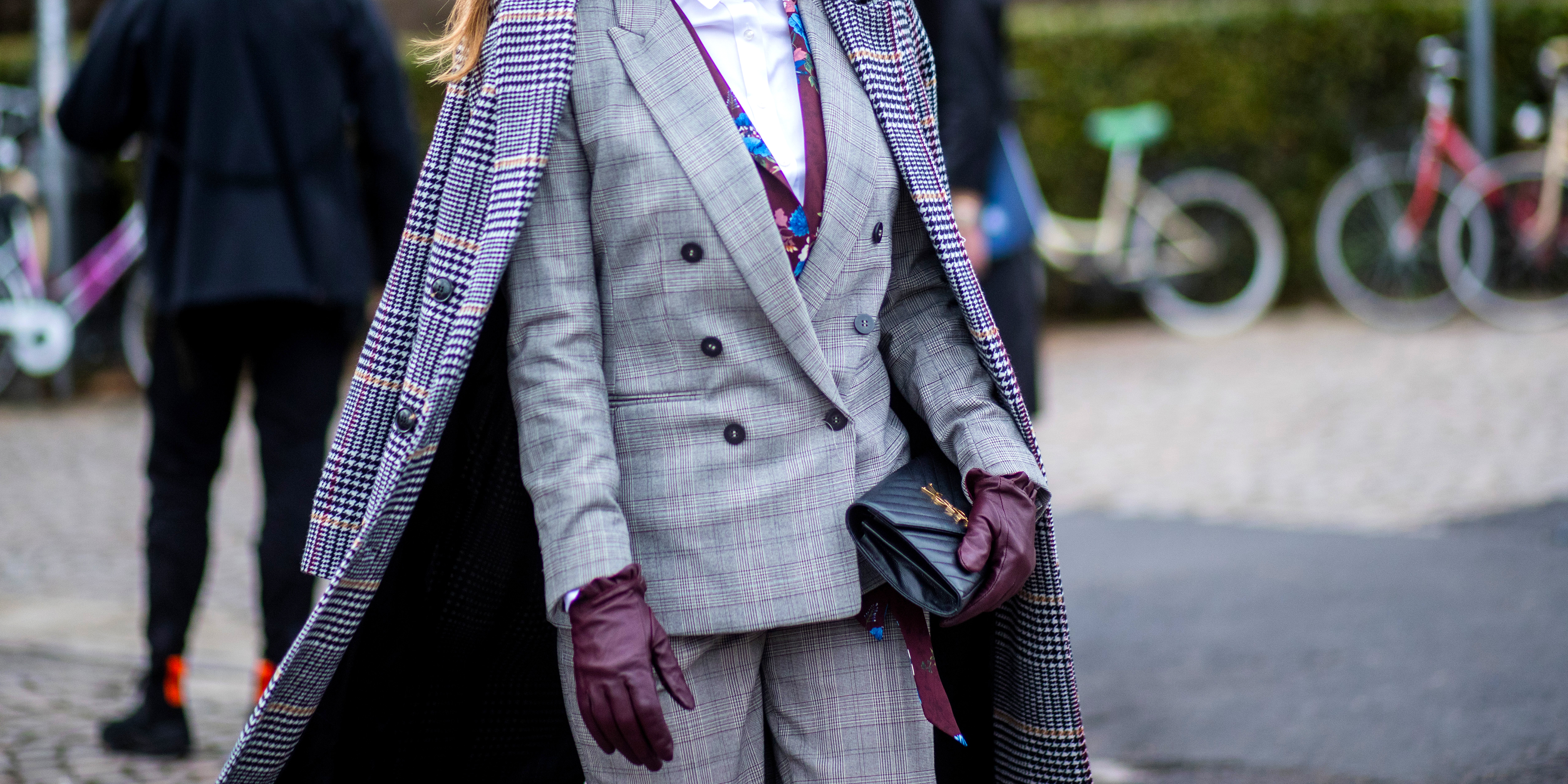 FLORENCE, ITALY - JANUARY 09: A guest wearing grey suit, gloves is seen during the 93. Pitti Immagine Uomo at Fortezza Da Basso on January 9, 2018 in Florence, Italy. (Photo by Christian Vierig/Getty Images)