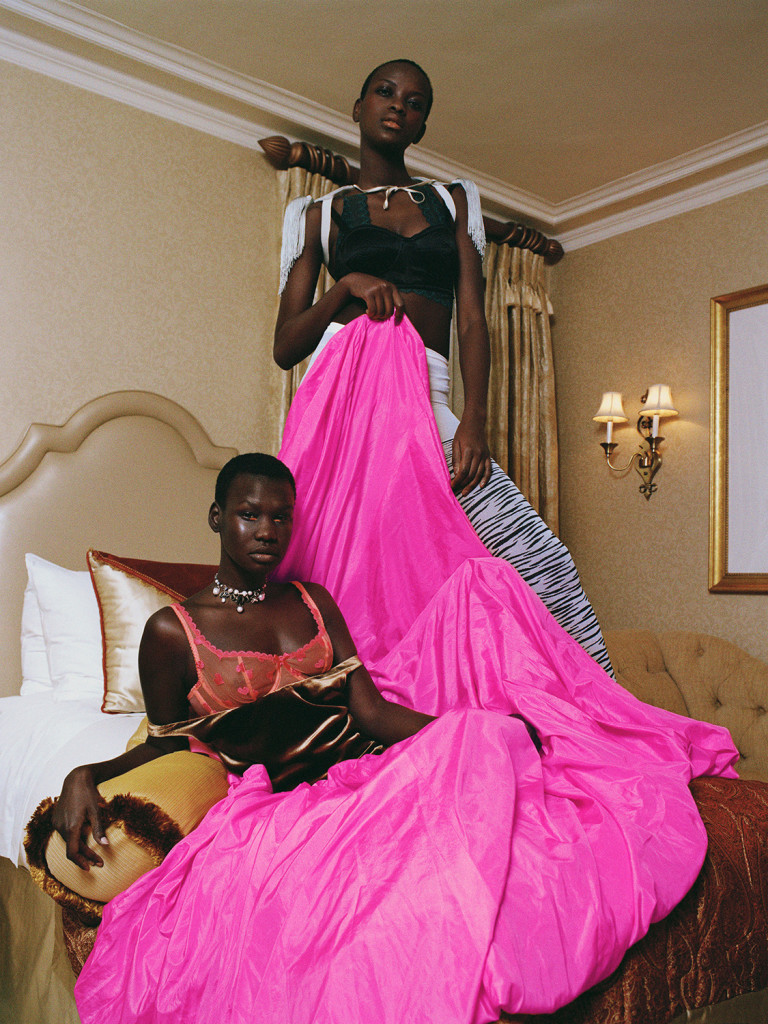 ADOT (LEFT) WEARS DRESS VALENTINO, BRA AGENT PROVOCATEUR, NECKLACE ALEXANDER MCQUEEN, HADDY (RIGHT) WEARS BRA ALEXANDER MCQUEEN, BRA (UNDERNEATH) KIKI DE MONTPARNASSE, TIGHTS STYLIST'S OWN, SHOT AT THE PIERRE HOTEL